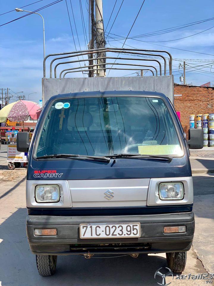 Cần nhượng bán xe tải Suzuki 5 tạ sx 2013 , đăng kí 2014 thùng mui bạt với giá 140 triệu